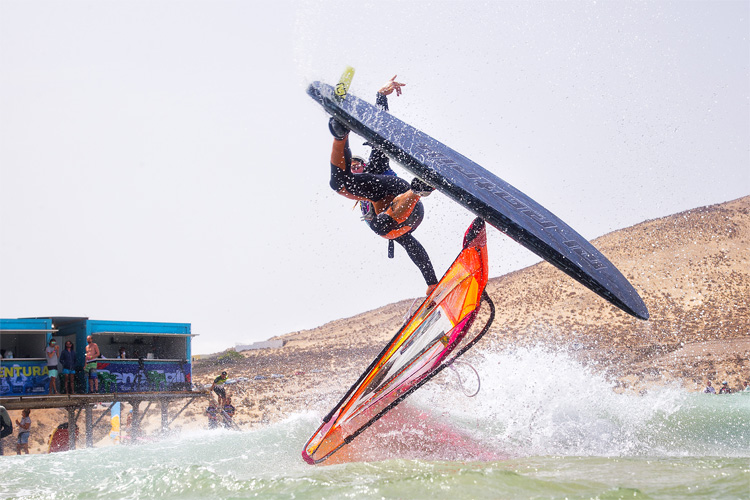 What is the difference between sailboarding and windsurfing?