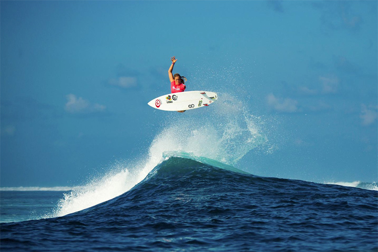 How does Bethany Hamilton surf with one arm?