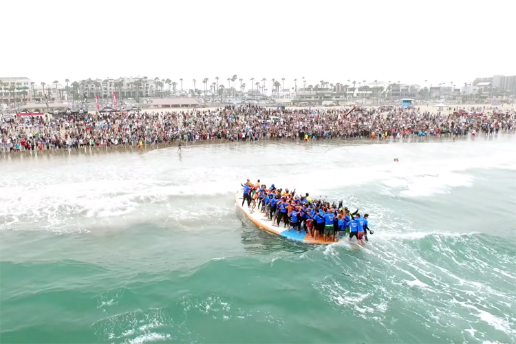 Huntington Beach: 66 surfers on a 42-foot surfboard