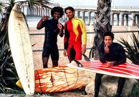 Black surfers: proudly wearing the new and exclusive firing wetsuits