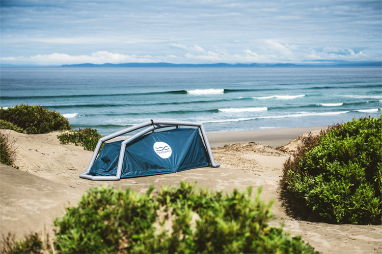 The surfboard bag that transforms into a tent
