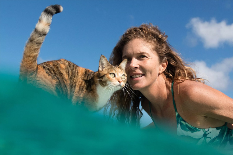 Captain Liz Clark: always in good company with Amelia, the Tropicat | Photo: Patagonia/Clark