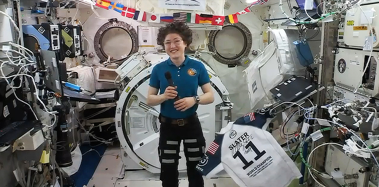 Christina H. Koch: floating in space alongside Slater's number 11 jersey