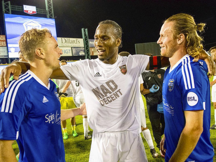 Didier Drogba (center) and Mackenzie Pridham (right): sharing the love of soccer | Photo: Pridham Archive
