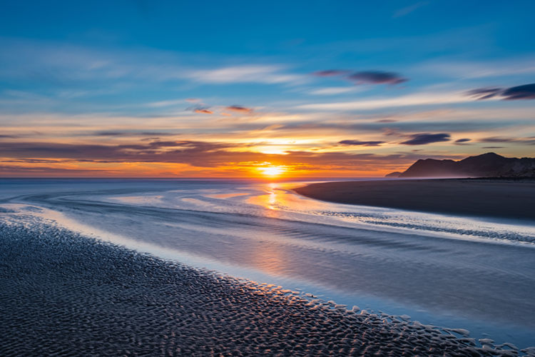 East Cape, New Zealand: the region witnesses the first sun rays of every new day | Photo: Shutterstock