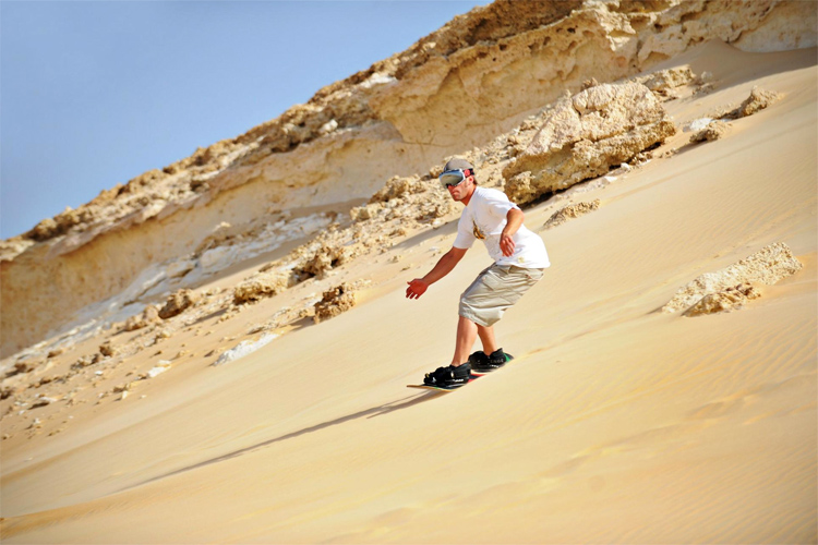 Sandboarding at Great Sand Sea, Egypt | Photo: Egypt Tourism Authority