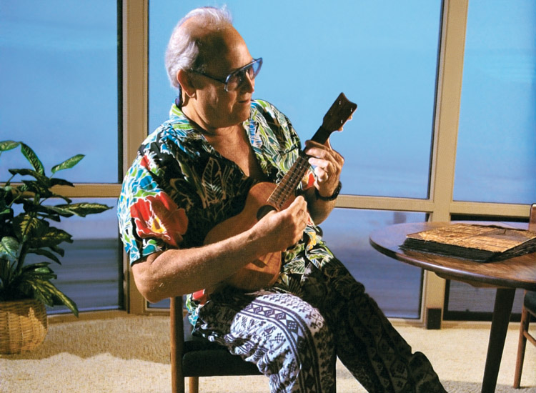 Walter Hoffman: the California big wave surfer and surf industry garmento leader plays the ukulele wearing a Hawaiian shirt | Photo: James Cassimus