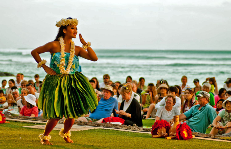 Hula dancer: women wear grass skirts, flowered shirts, wrist and ankle bracelets, and leis | Photo: Ray_LAC/Creative Commons