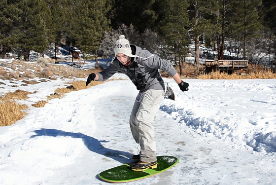 Ice Skimboarding: sliding over the speed strip