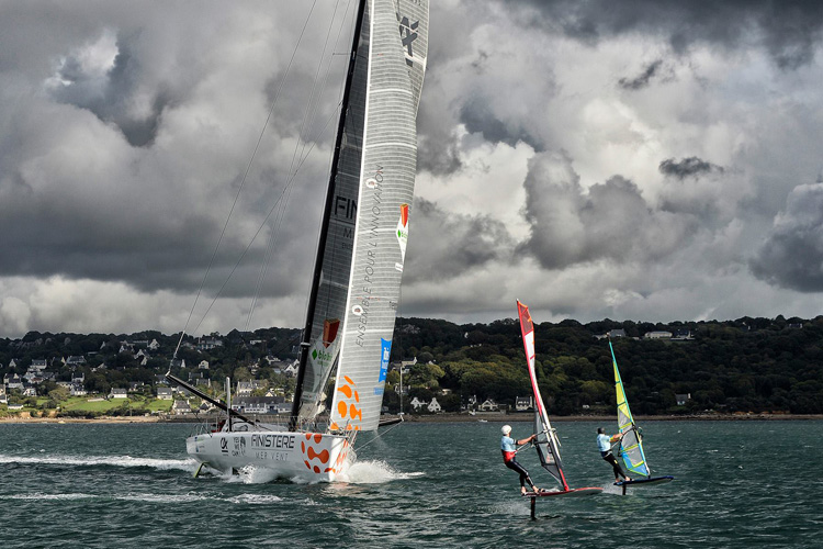 IMOCA vs Windsurfer: the battle of the sails at the 2017 Finist'Air Sailing | Photo: Bellande/Finist'Air Sailing