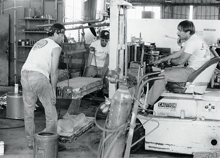 Eric Swenson, Craig Stecyk and Fausto Vitello, circa 1983: working at the Independent Truck Co foundry in San Francisco, California | Photo: MoFo