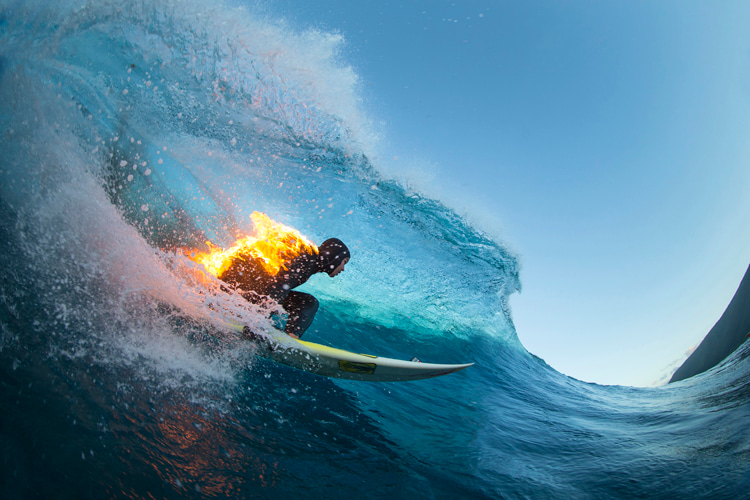 Jamie O'Brien: barreled and fired up at Tahiti's Teahupoo | Photo: Red Bull