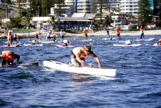 Jamie Mitchell wins the Honoula Ocean Paddle Race on the Gold Coast