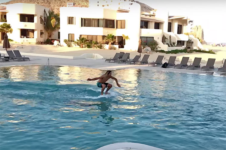 Austin Keen skims across a swimming pool