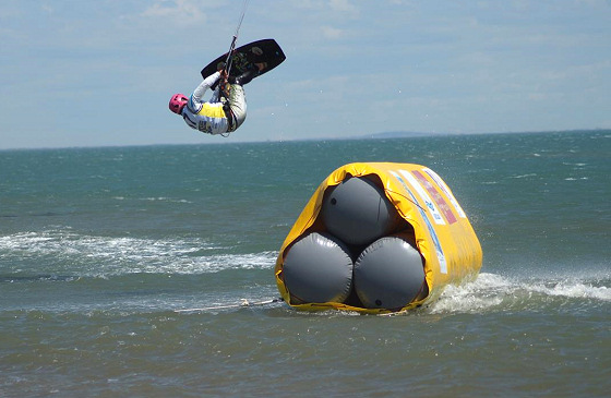Kite Boarder Cross: jumping over a set of explosives