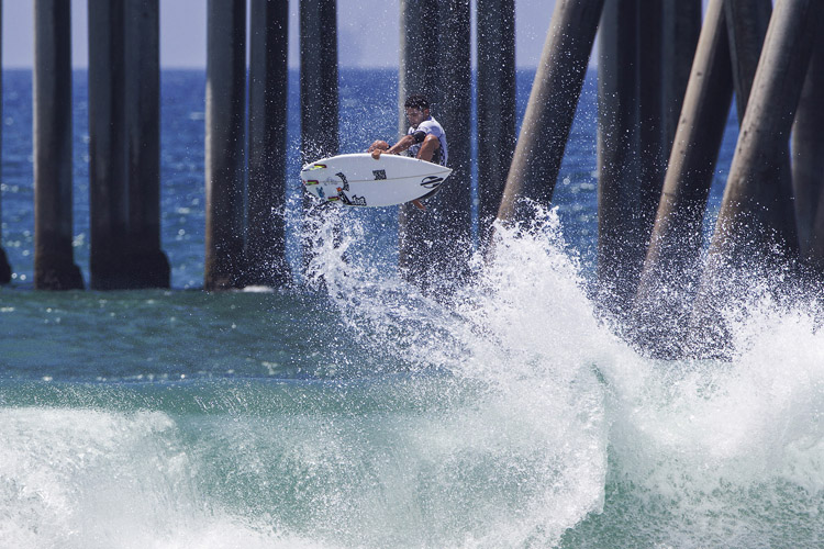 Michael Rodrigues: mind the pier | Photo: Rowland/WSL