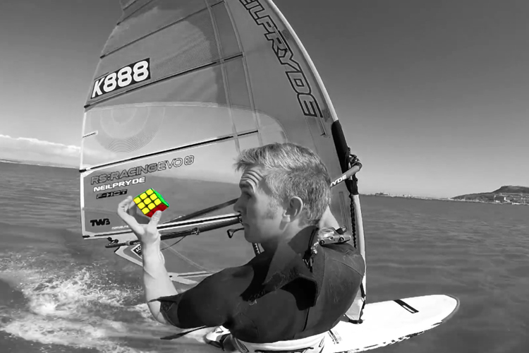 Michael George: he solves the Rubik's Cube while windsurfing