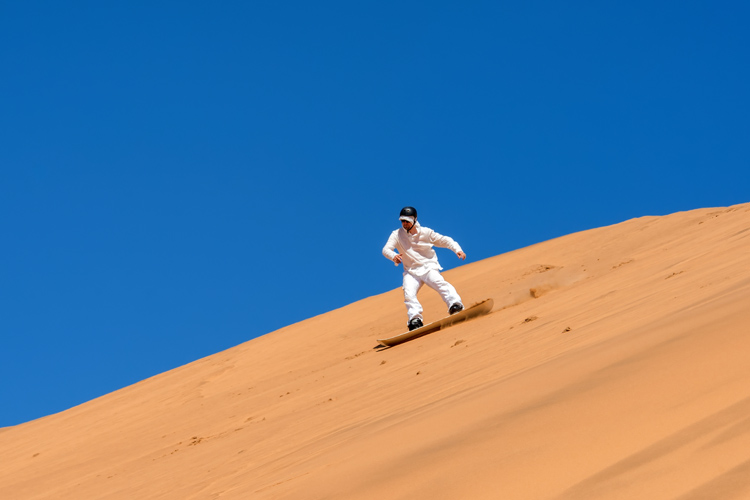 Sandboarding in the Namib Desert, Namibia | Photo: Shutterstock