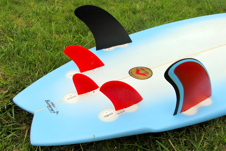 The Five-Fin Setup: four side fins and a small centered fin attached to the surfboard