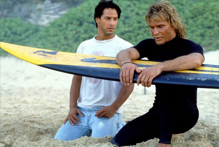 Point Break: Keanu Reeves and Patrick Swayze sharing the stoke of surfing