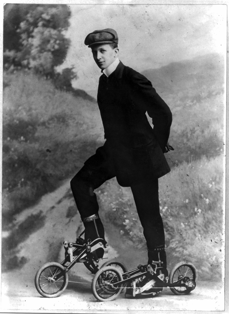 Roller skating, 1910: a young man stands on miniature, two-wheeled bicycle-like roller skates | Photo: Library of Congress