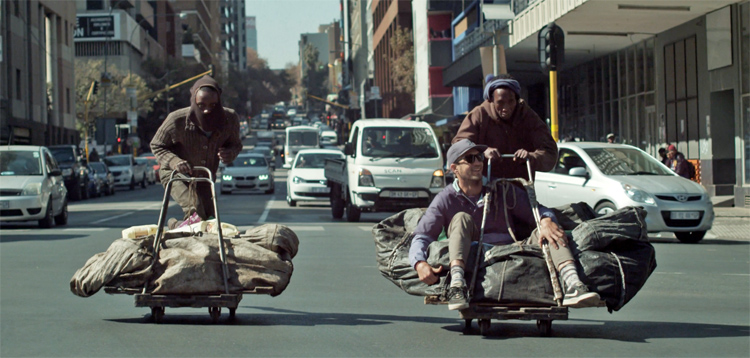 Street surfers: Mokete and Thabo give Frank Solomon a ride