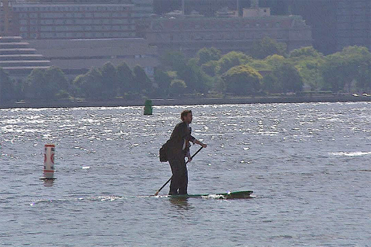 Man in suit crosses Hudson River on SUP to make meeting on time
