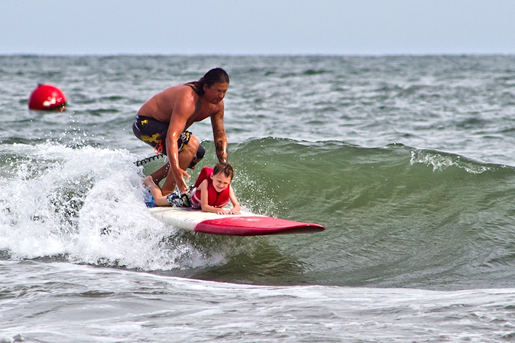 Surfers Healing: Israel Paskowitz gets a grom onboard | Photo: throughcannonseyes.com