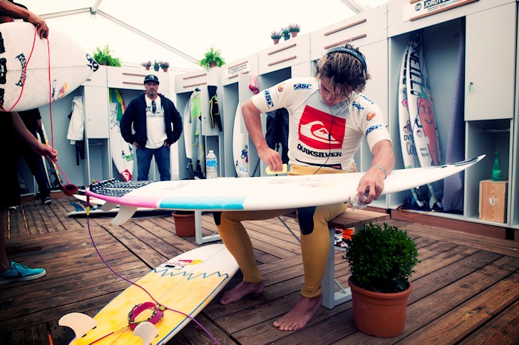 Pro surfer: waxing the surfboard for the 10th time