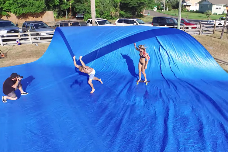 Tarp surfing: all you need is a skateboard, a large blue tarp and a couple of friends