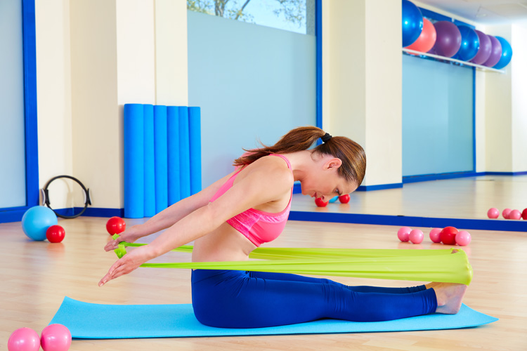 Pilates for Surfers: The Spine Stretch Forward | Photo: Shutterstock