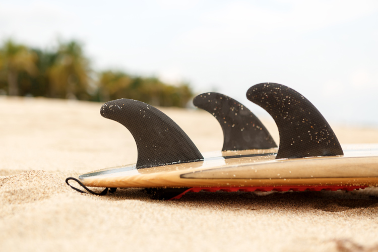 The Thruster Setup: two side fins and a center fin attached to the surfboard