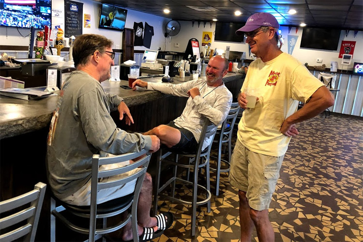 Tony Vandenberg (right): learning more about pound nets and hearing stories of hallucinations at Sharky's | Photo: Vandenberg