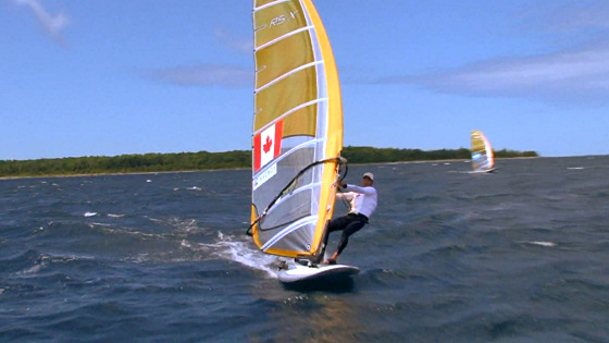 Windsurfers round the Christian Island: religious dedication to the sport