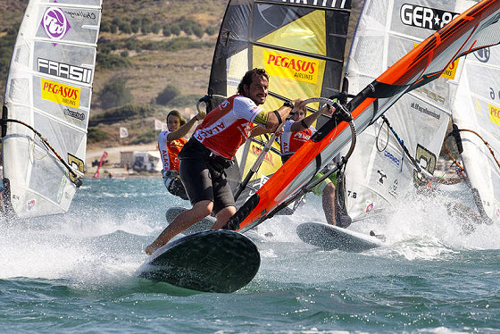 Slalom windsurfing: touch the mark and grab the boat